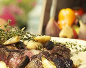Rib Eye Steak with Black Pepper Mission Figs, Roasted Garlic, and Thyme
