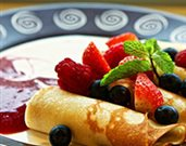 French Crepes with Cream Filling and Strawberry Topping