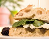 Olive Tapenade, Goat Cheese, and Baby Spinach Sandwich