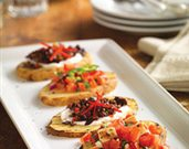 Festive Papas Tapas with a Mediterranean Topping