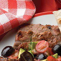 Grilled Flank Steak with Avocado and Olive Salsa