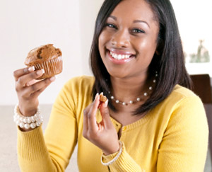 Woman eating a muffin