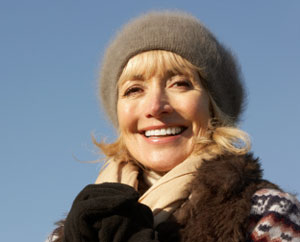 Smiling Woman Outdoors Wearing Hat