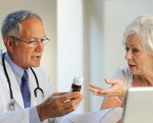 Mature women speaking with doctor