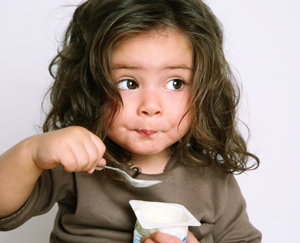 Child Eating Yogurt