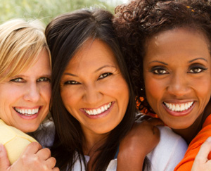 Three happy multicultural women