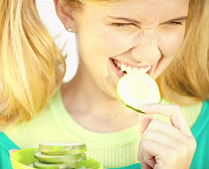 Girl Eating Cucumber Slices