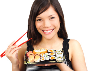 Smiling Woman Eating Sushi