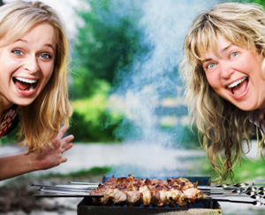 @ Women Grilling and Smiling