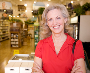 Woman smiling in a grocery store