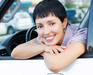 Woman smiling in her car