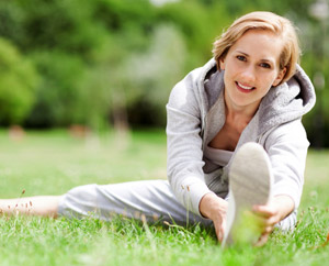 A Woman Stretching in the Grass