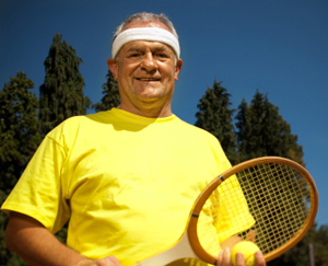 Mature man with tennis racket