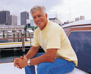 Smiling man sitting on a boat