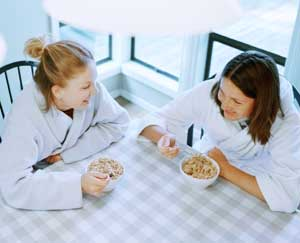 Two Girls Eating Cereal