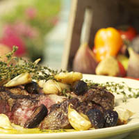 Rib Eye Steak with Black Pepper Mission Figs, Roasted Garlic, and Thyme: Main Image