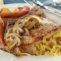Curried Raisin Rice Stuffed Pork Rib Chops with Caramelized Onions and Mushrooms: Main Image