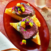 master.k.m.us.TBCO AnchoChiliBeefonCornbreadCrostini Smoky Paprika Rubbed Beef Tenderloin with Roasted Root Vegetables