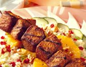 Grilled Pork, Couscous, and Dried Cherry Salad with Citrus Vinaigrette